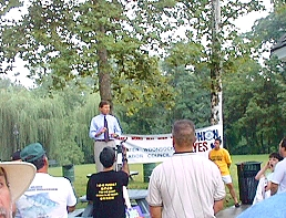 Former Congressman Weygand addresses the crowd in River Island Park